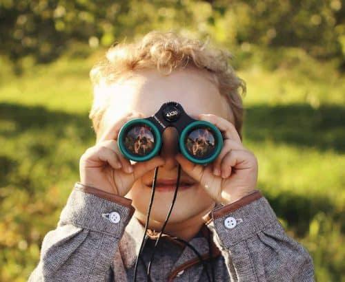 Boy with green binoculars