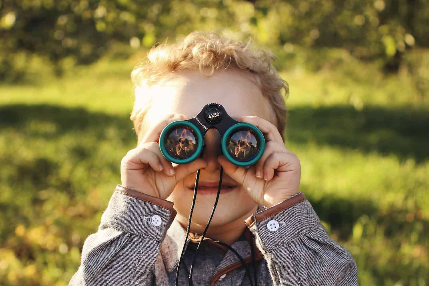 Boy with green binoculars